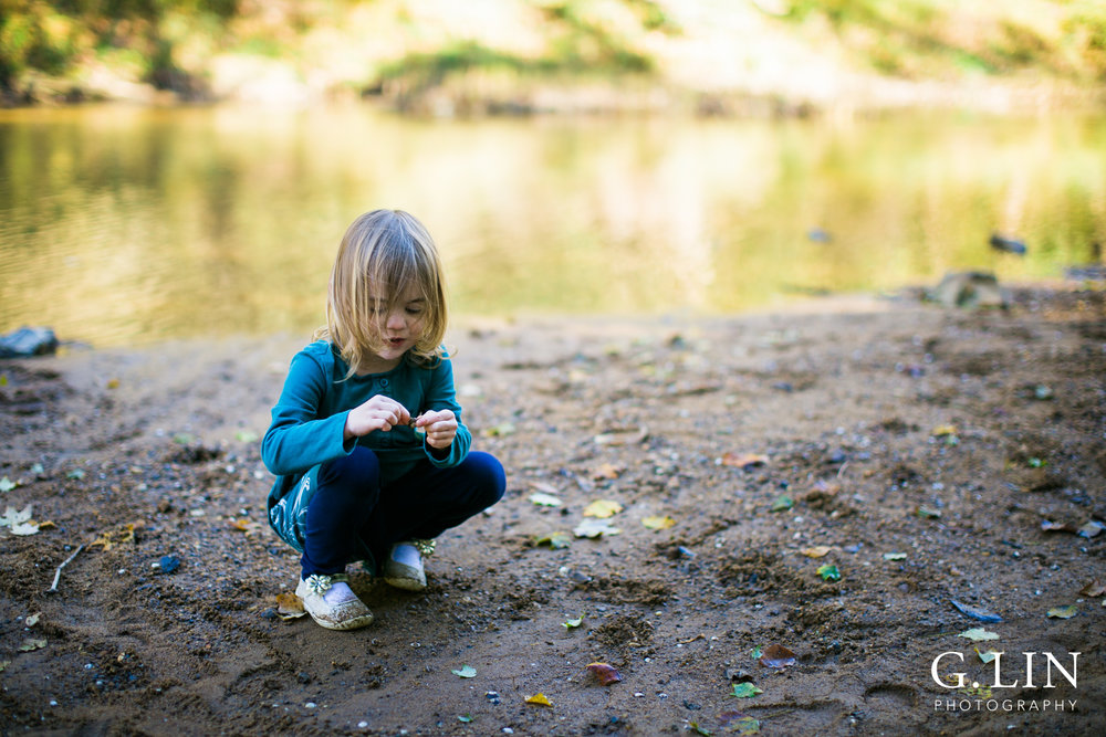 Durham Family Photographer | G. Lin Photography | Girl playing in sand by river