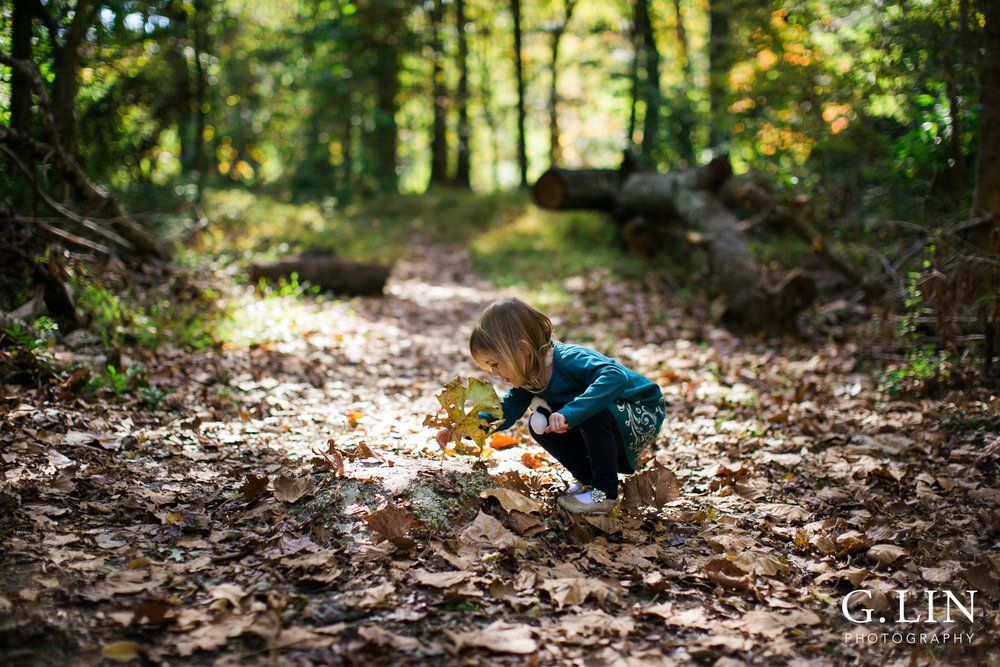 Durham Family Photographer | G. Lin Photography | girl holding leaf and playing with leaves