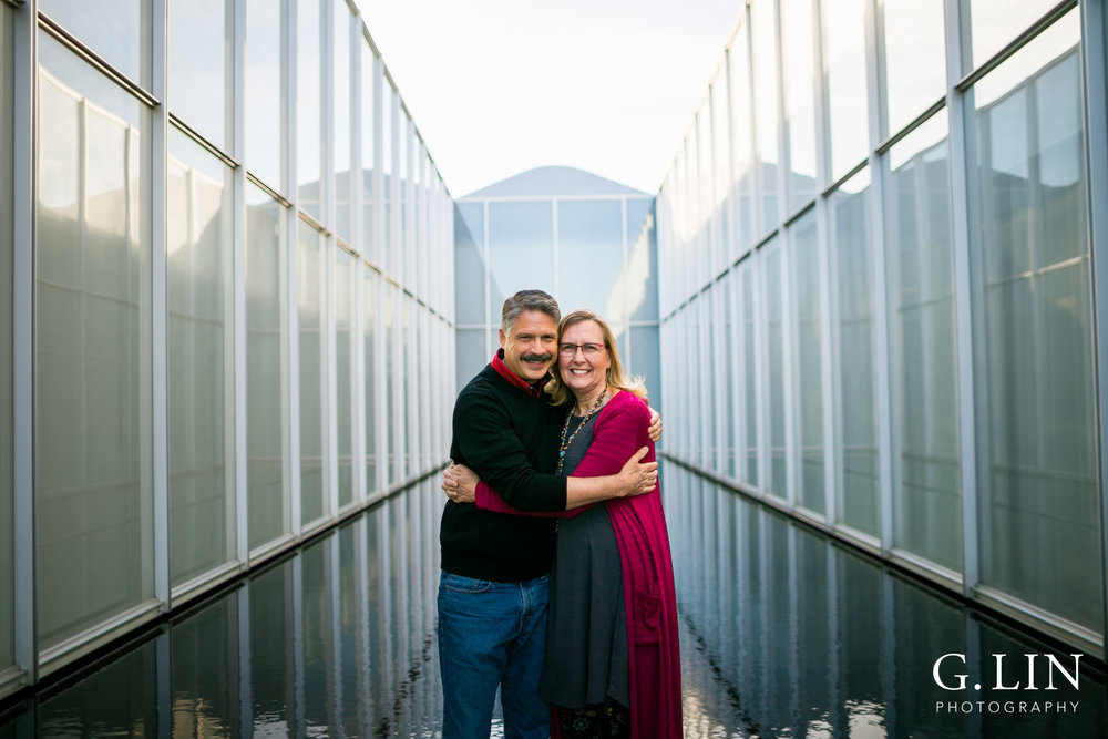 Raleigh Family Photographer | G. Lin Photography | Couple hugging each other at NCMA
