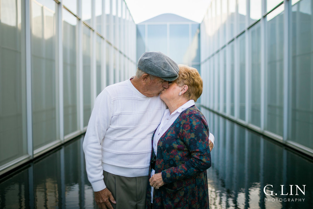 Raleigh Family Photographer | G. Lin Photography | Husband and wife kissing at NC Museum of Art