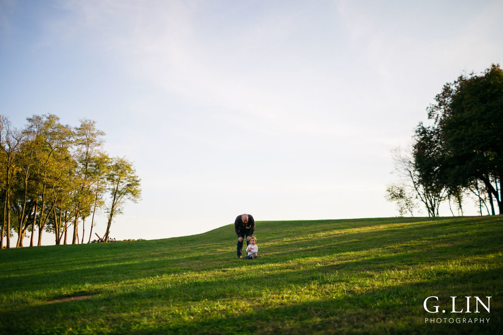 Raleigh Family Photographer | G. Lin Photography | Dad talking to daughter in the field
