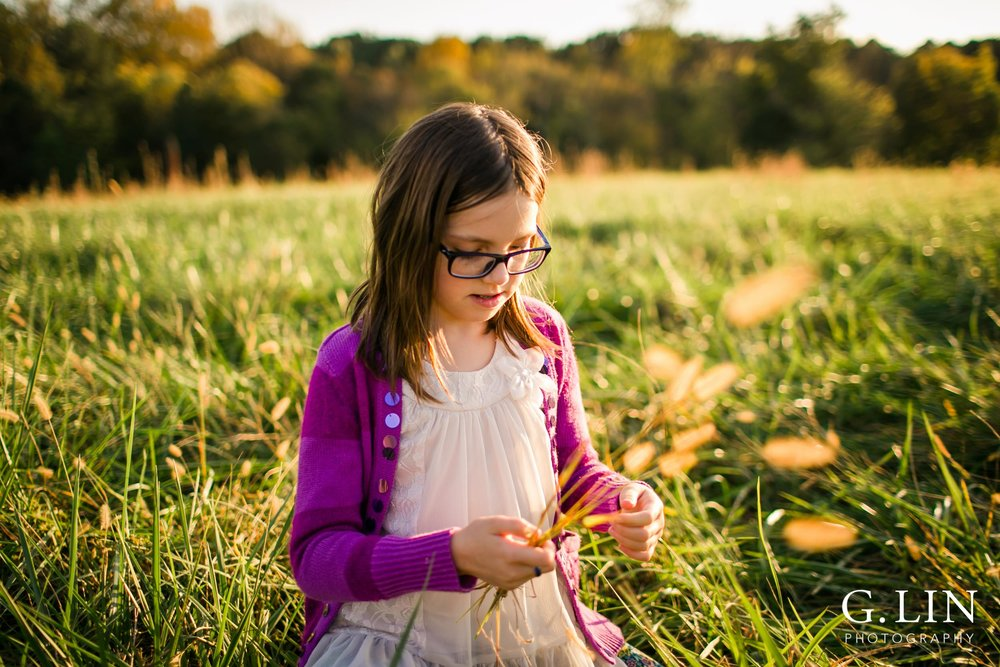 Raleigh Family Photographer | G. Lin Photography | Girl playing in open field