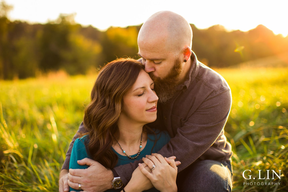 Intimate embrace of couple in open field at NC Museum of Art | Raleigh Family Photographer | G. Lin Photography