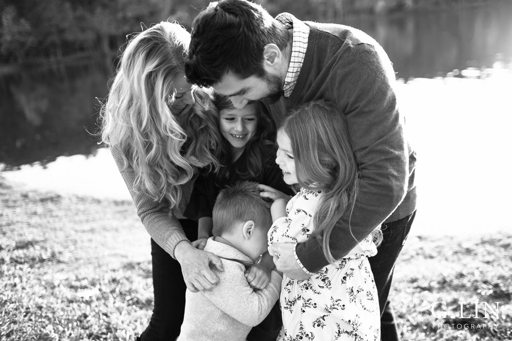 Raleigh Family Photographer | G. Lin Photography | black and white photo of family hugging