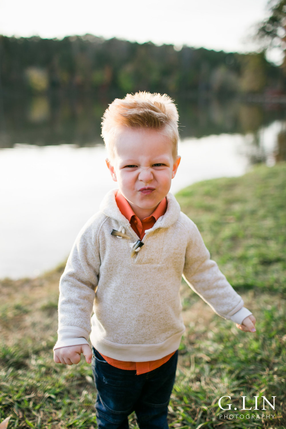 Raleigh Family Photographer | G. Lin Photography | portrait of youngest sibling making a funny face