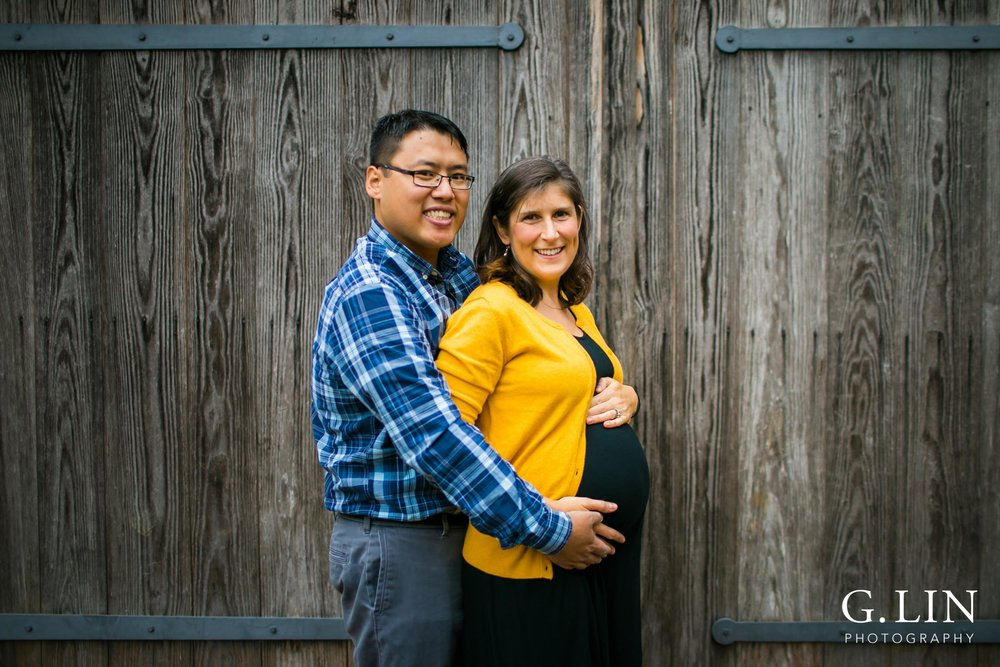 Durham Family Photography | G. Lin Photography | Maternity photo of couple next to wall