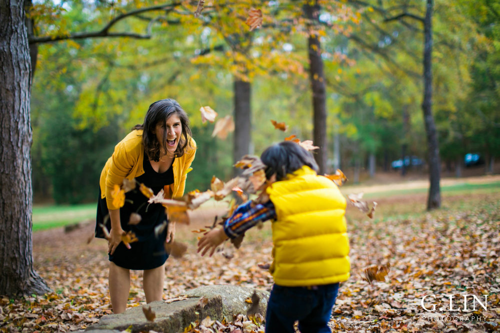 Durham Family Photography | G. Lin Photography | Mother and son playing with fall leaves