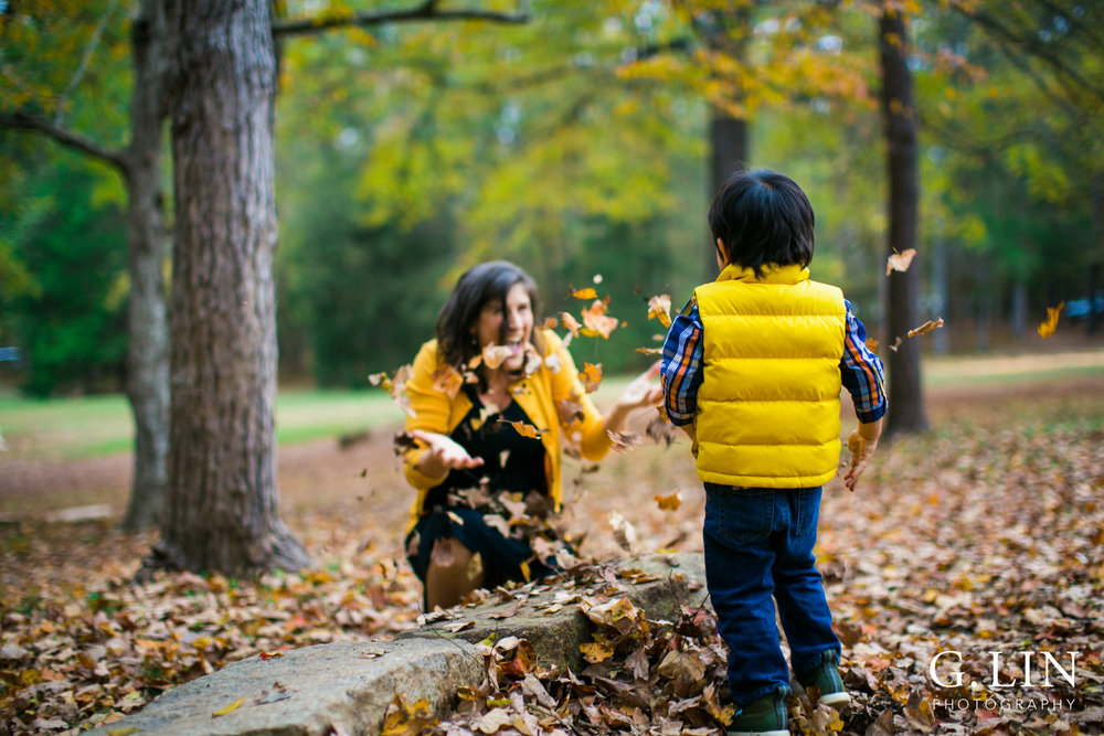 Durham Family Photography | G. Lin Photography | Playing with the leaves in the park