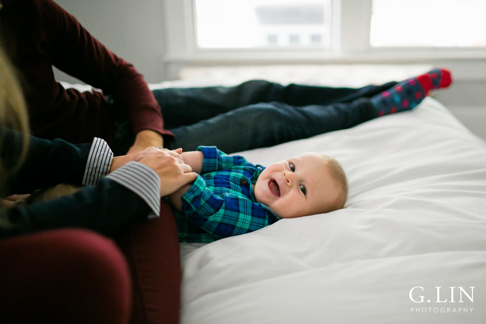 Durham Family Photographer | G. Lin Photography | cheerful baby boy on white bed sheet