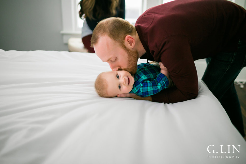 Durham Family Photographer | G. Lin Photography | dad kissing baby son on cheek