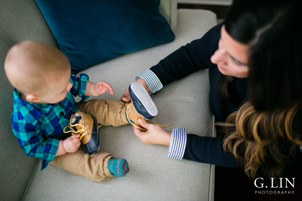Durham Family Photographer | G. Lin Photography | birds eye view of mom putting shoes on baby