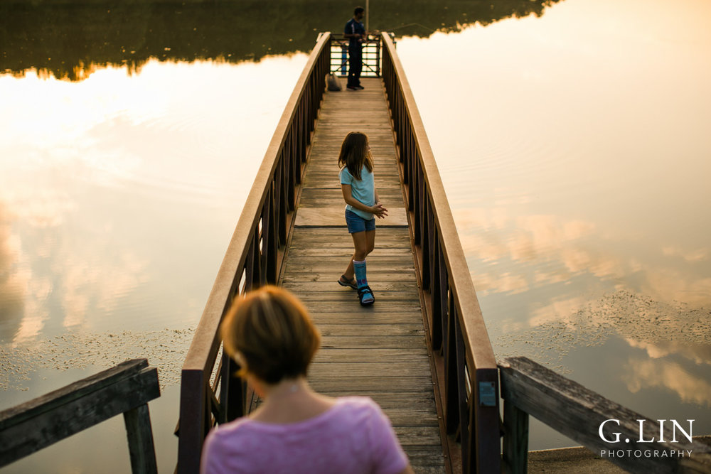 Raleigh Family Photographer | By G. Lin Photography | Creative photo of girl on bridge by the lake