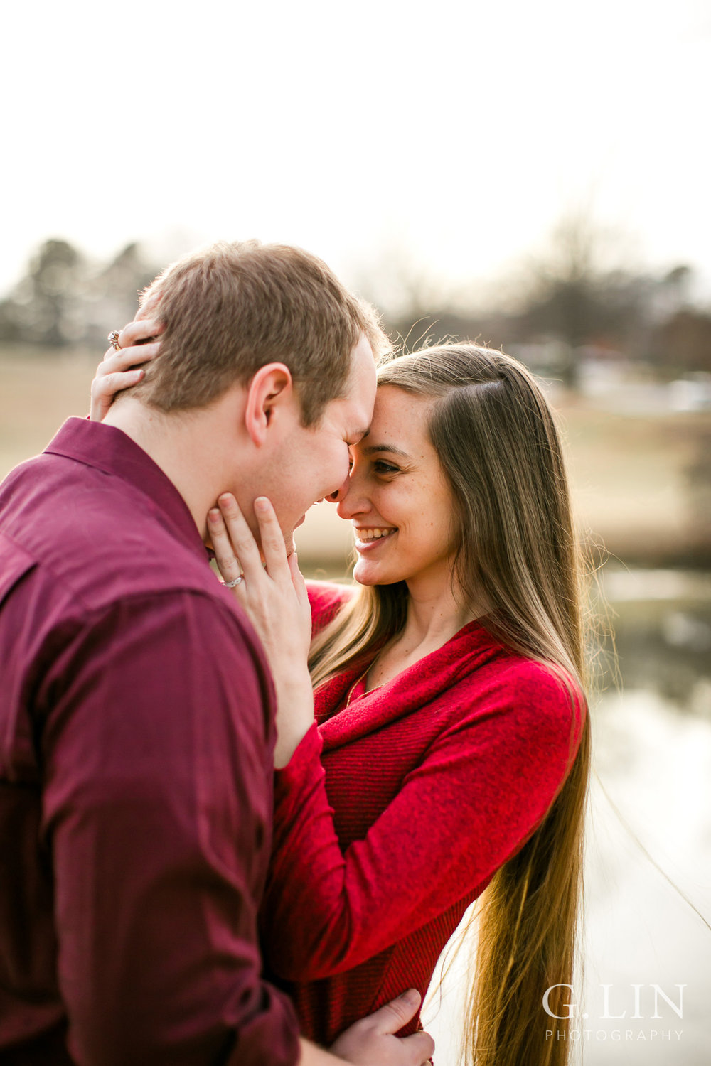 Couple looking at each other outside | Raleigh Engagement Photographer | By G. Lin Photography