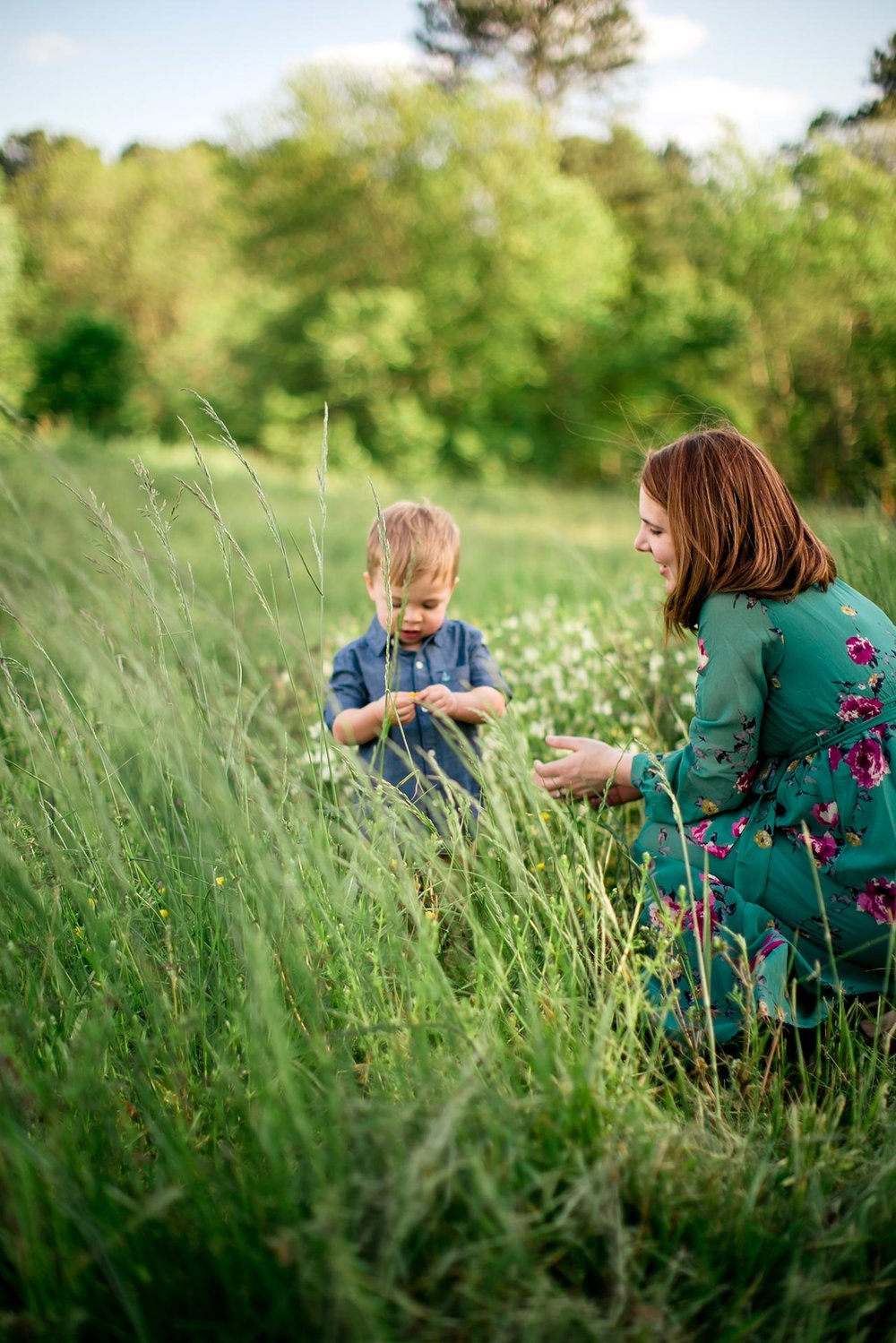 Raleigh Family Photographer | G. Lin Photography | Mother and son playing in the field at NC Museum of Art