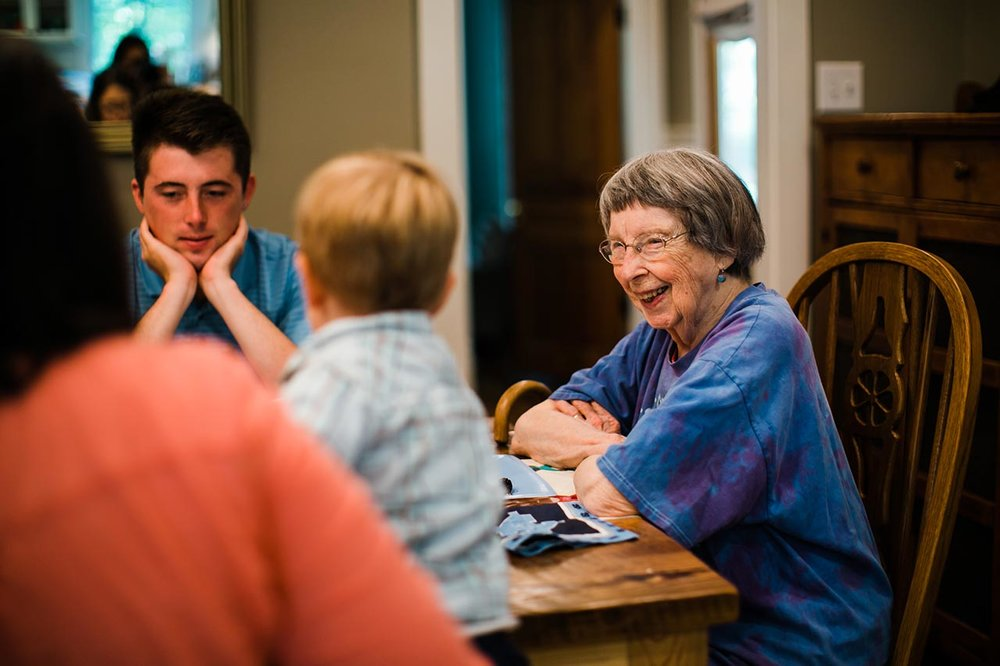 Candid photo of grandma | Graduation Portraits for UNC Student | By G. Lin Photography | Durham Graduation Photographer