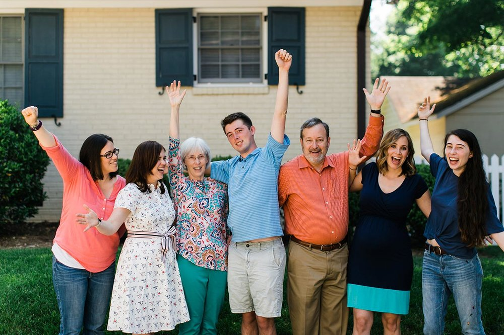 Family Cheering | Graduation Portraits for UNC Student | By G. Lin Photography | Raleigh Photographer