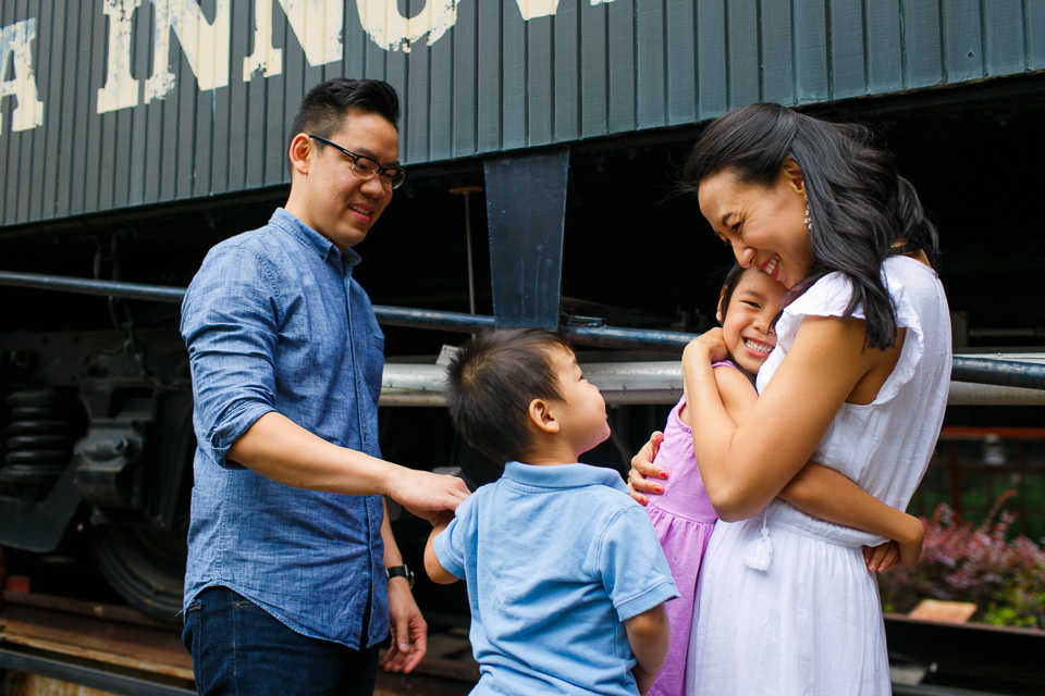 Family hugging outside in Downtown Durham | Family Photographer in Durham, NC | By G. Lin Photography