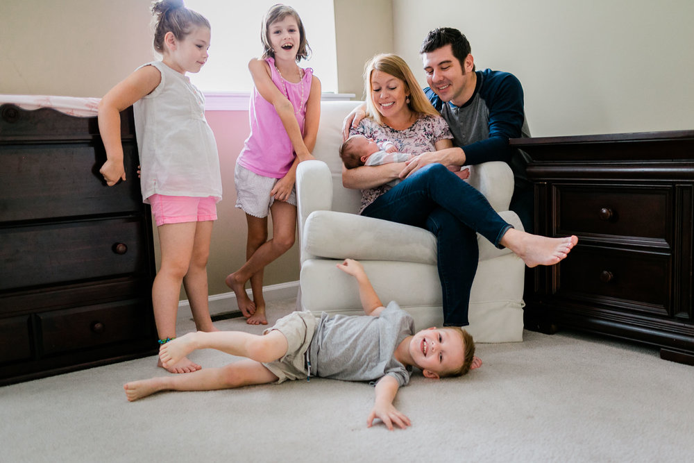 Raleigh Newborn Photography | By G. Lin Photography | Boy playing with family at home