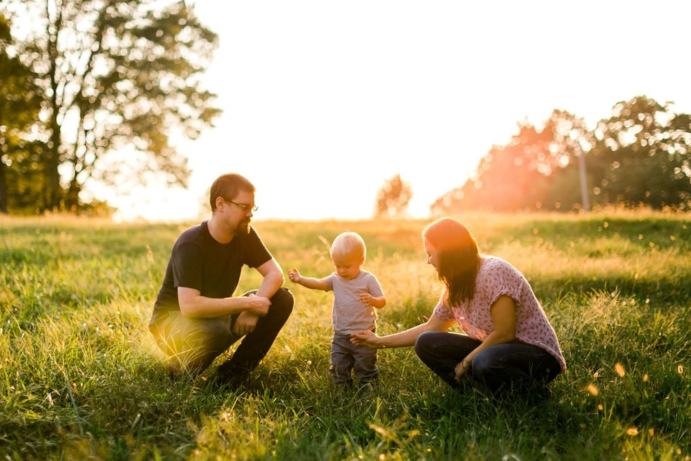 Family playing during golden hour sunset in open field | By G. Lin Photography | Rougemont Family Photographer