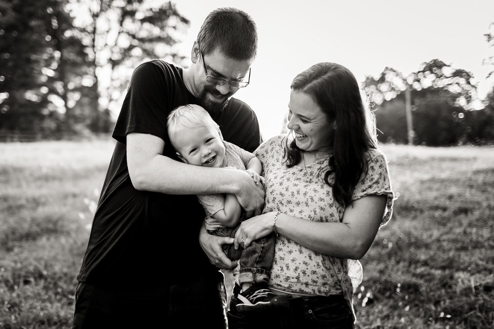Cute black and white photo of family outdoors | By G. Lin Photography | Durham Family Photography