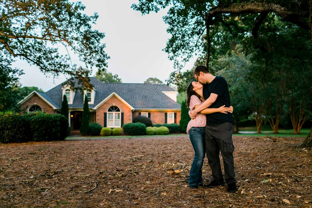 Portrait of husband and wife in front of house | By G. Lin Photography | Rougemont Family Photographer