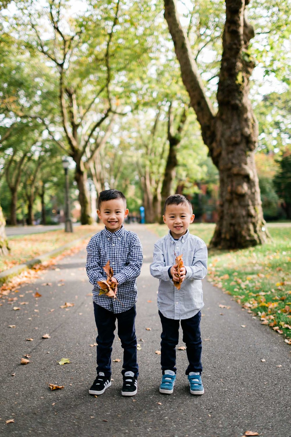 Boys holding leaves | Durham Family Photographer | By G. Lin Photography