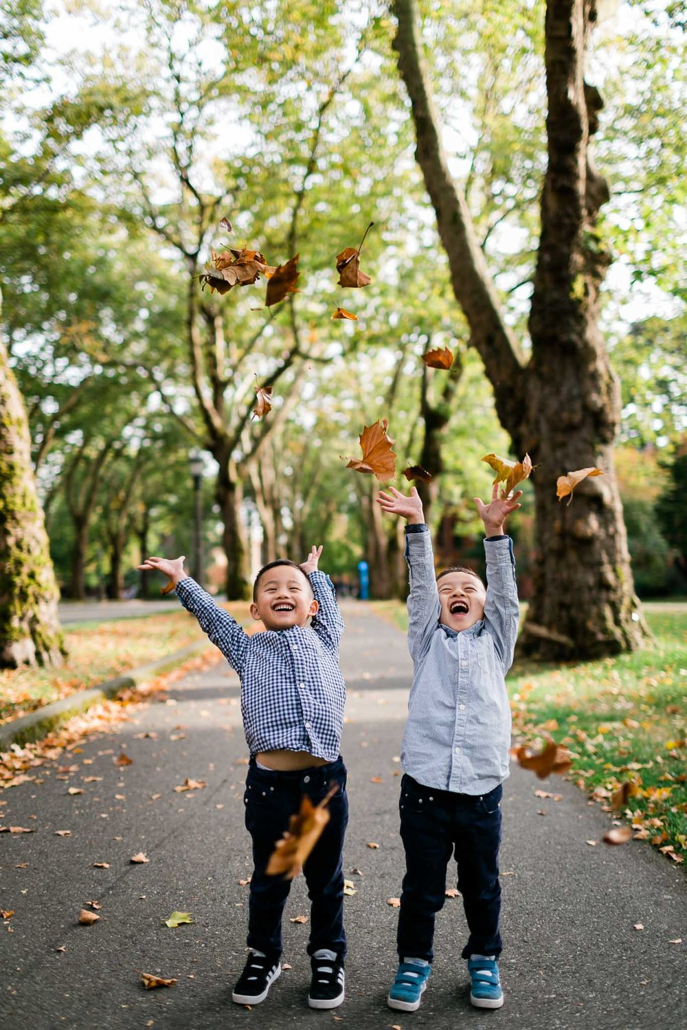 Twin boys throwing leaves in the air | Durham Family Photographer | By G. Lin Photography