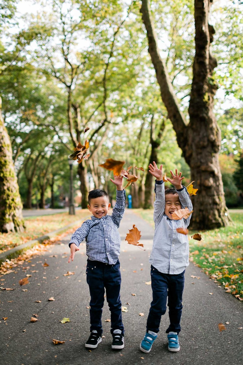 Boys laughing with leaves falling | Durham Family Photographer | By G. Lin Photography