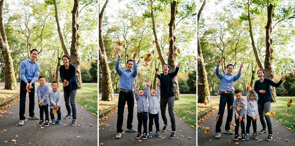 Family throwing leaves in the air at UW campus | Seattle Family Photographer | By G. Lin Photography