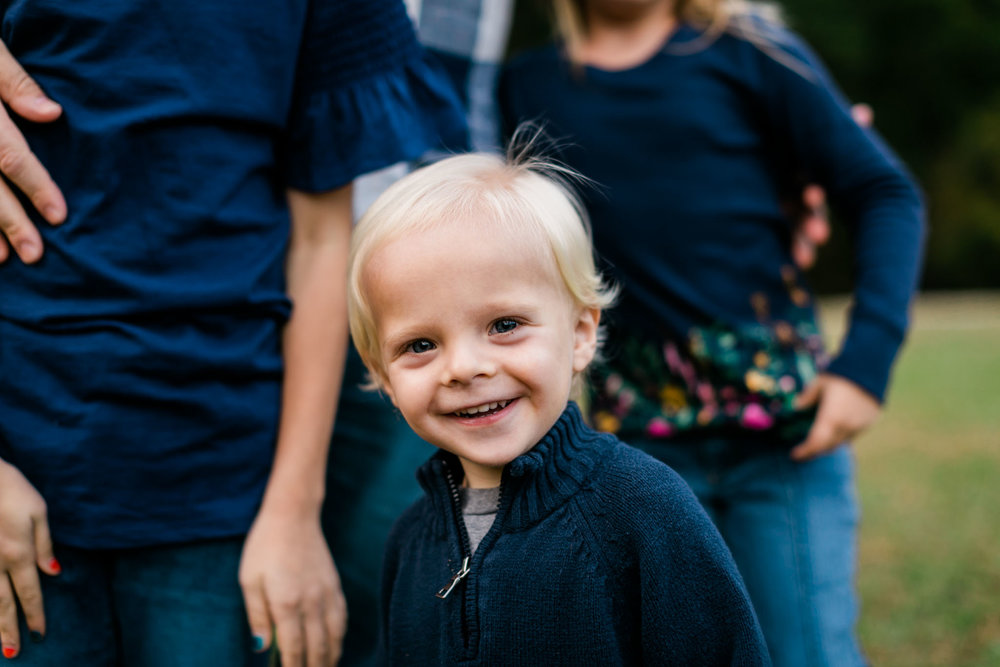 Toddler boy smiling at camera at Umstead Park | Raleigh Family Photographer | By G. Lin Photography