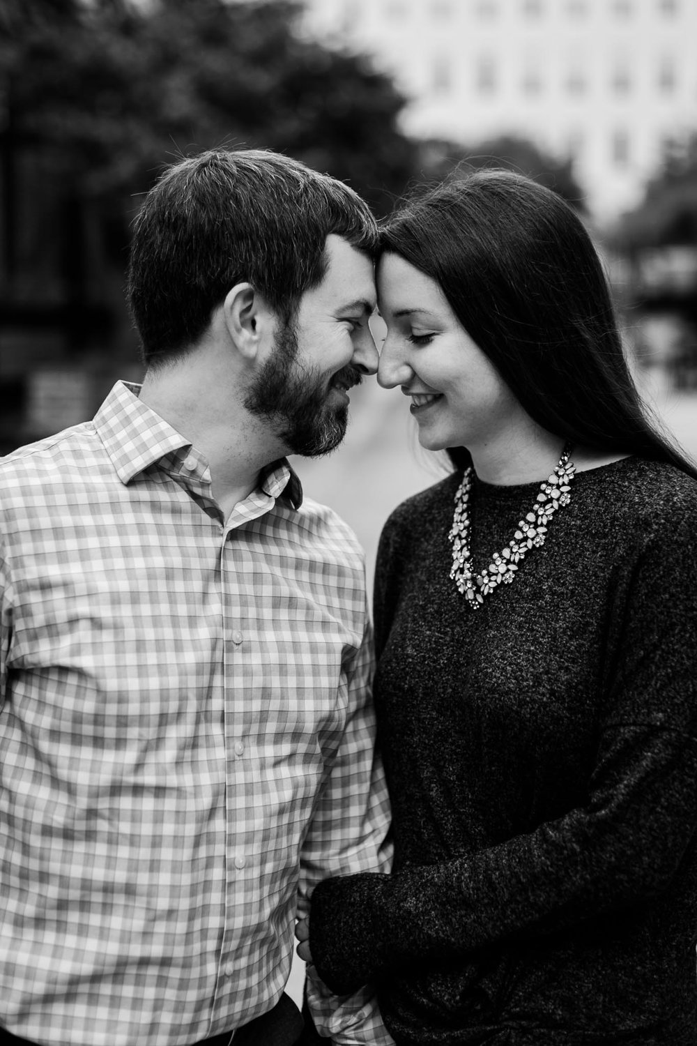 Black and white photo of couple in downtown durham | Durham Photographer | By G. Lin Photography