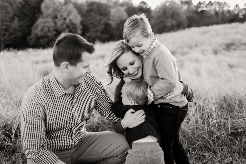 Fall family photo in black and white, outdoors in open field at NCMA | Raleigh Family Photographer | By G. Lin Photography