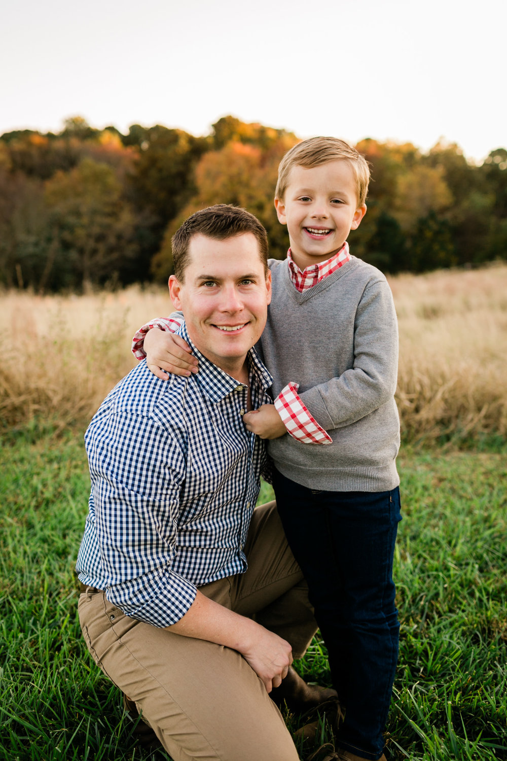 Father and son photo outside in open field at NC Museum of Art | Raleigh Family Photographer | By G. Lin Photography