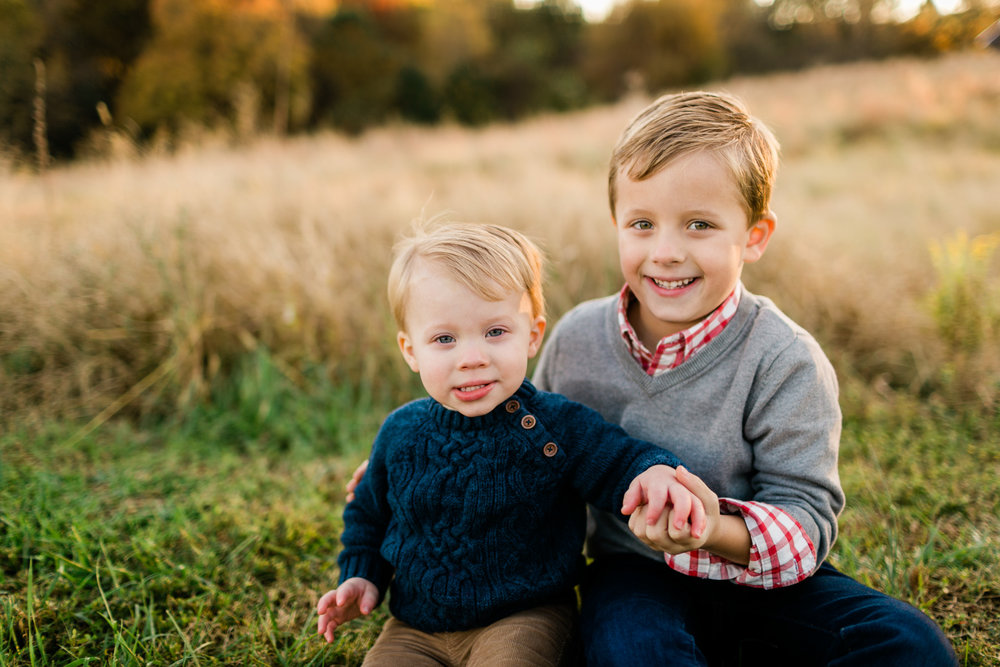 Cute photo of brothers sitting on grass | Raleigh Family Photographer | By G. Lin Photography