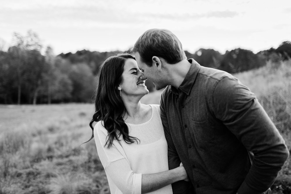 Black and white photo of couple kissing | Raleigh Photographer | By G. Lin Photography