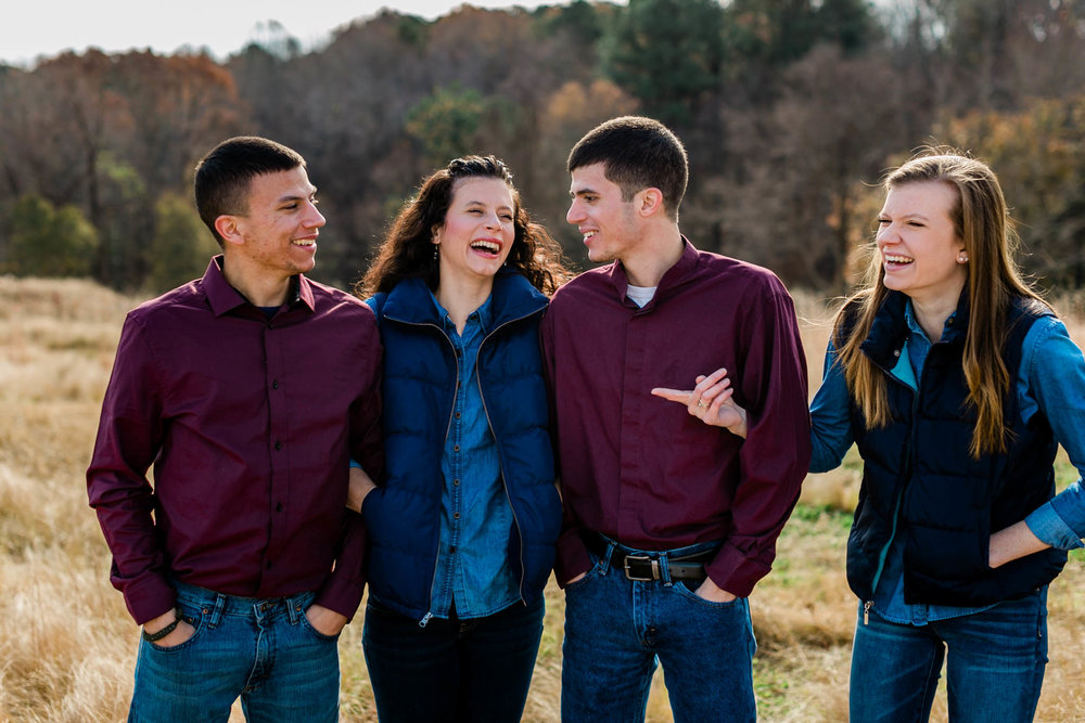 Candid portrait of people laughing | Raleigh Family Photographer | By G. Lin Photography