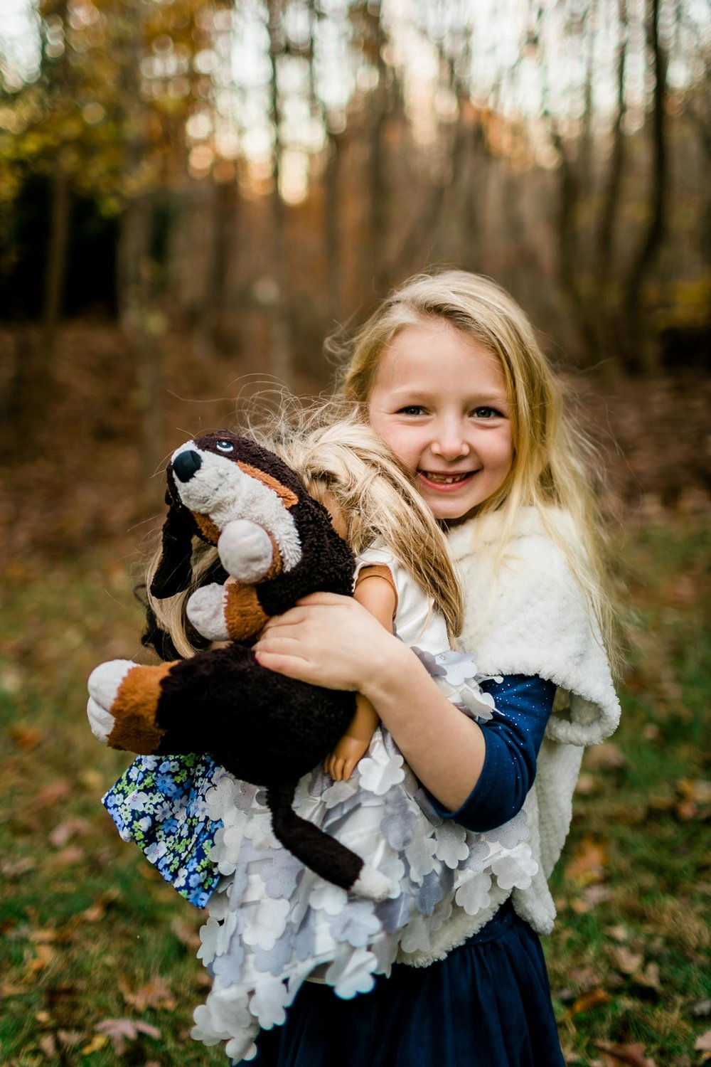 Young girl holding stuffed animals | By G. Lin Photography | Raleigh Family Photographer