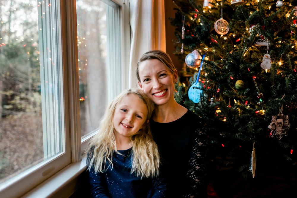 Mother and daughter sitting by Christmas tree | By G. Lin Photography | Durham Photographer