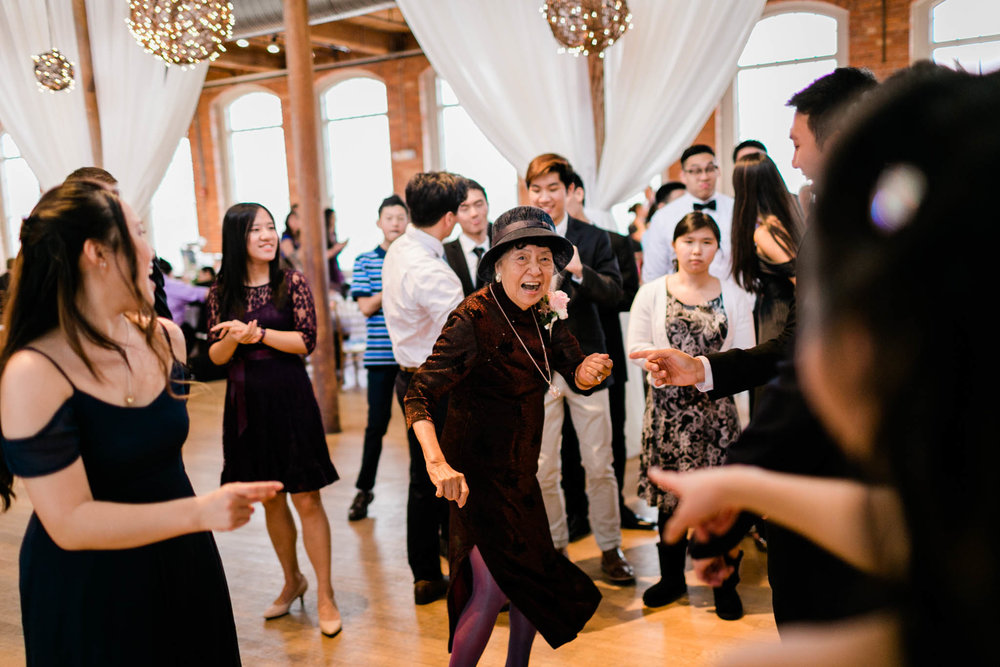 Grandma dancing during wedding reception | Durham Wedding Photographer | The Cotton Room | By G. Lin Photography
