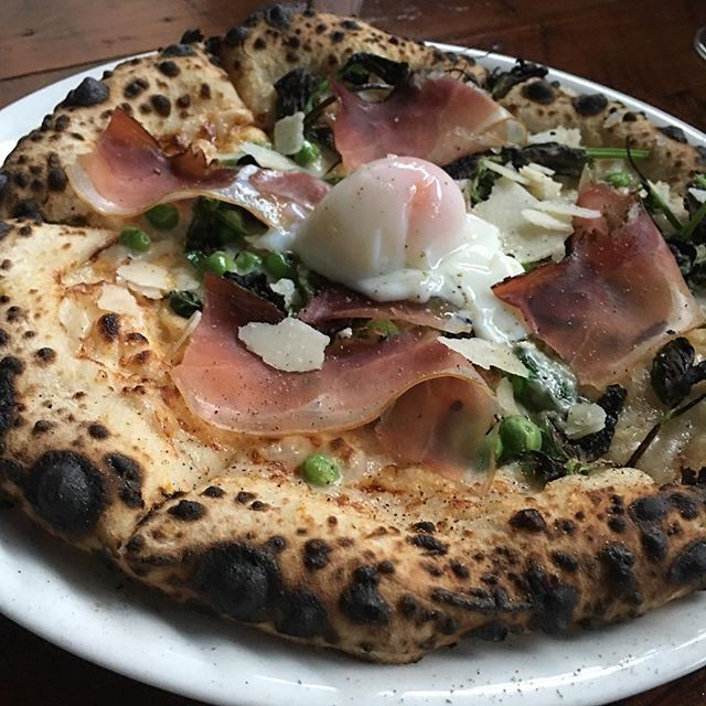 New pizza @sottola. Not for the faint of heart. Literally. Speck, cream, parm, peas, soft egg.
