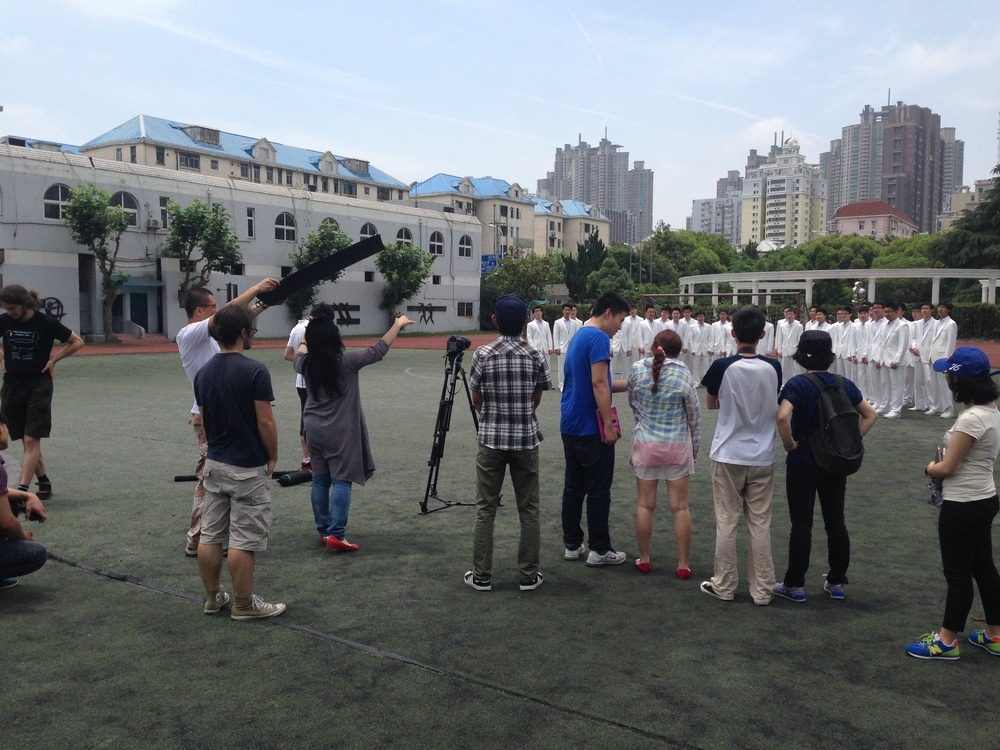 Shooting the choir singing on campus of Yangjing High School.