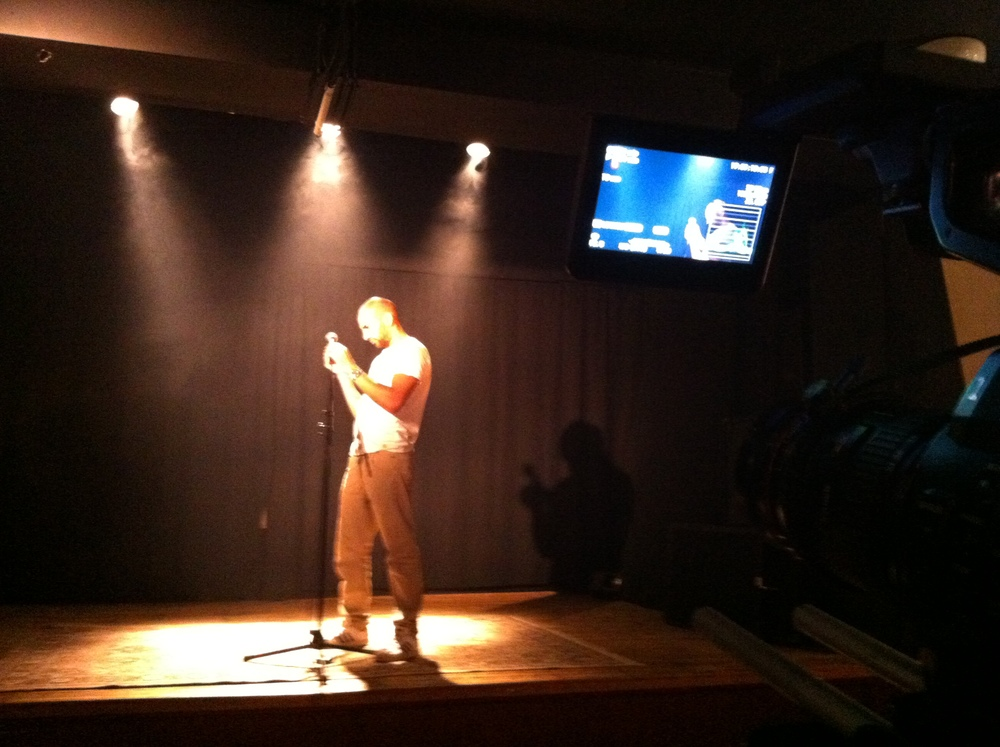 Shooting Slam Poetry: Runner Julian fixing the microphone.