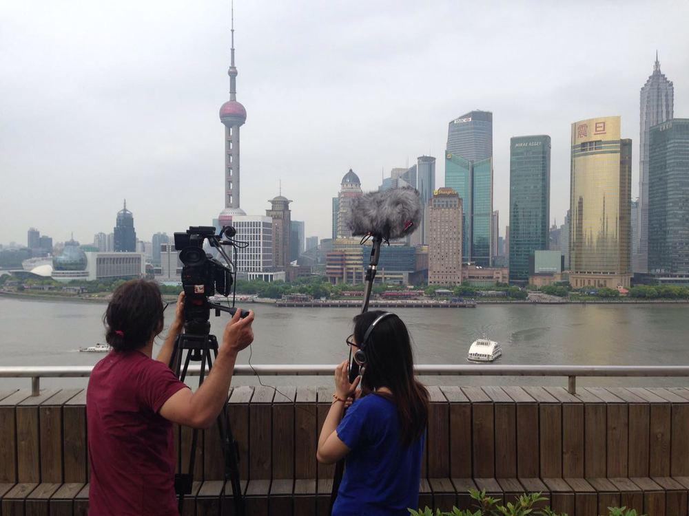 Photographing the buildings in Shanghai.