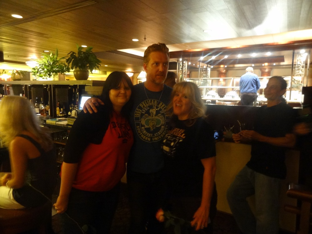 Joshua Homme from Queens of the Stone Age with Jaye and Meghan at our hotel bar