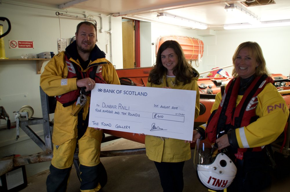 Amy Christie (centre) of the Found Gallery presents her cheque to Chris Woods (left) and Rebecca Miller (right) of Dunbar lifeboat crew. (photo: Gaz Crowe)