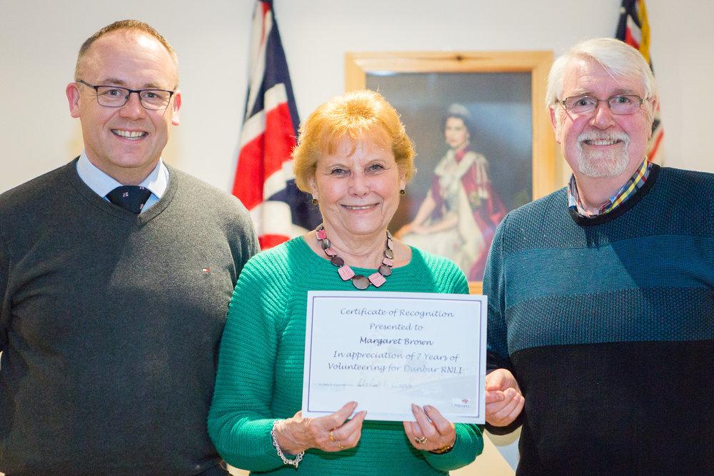 Margaret Brown (7 years service - shop volunteer), with Mark Lees and Ken Headley