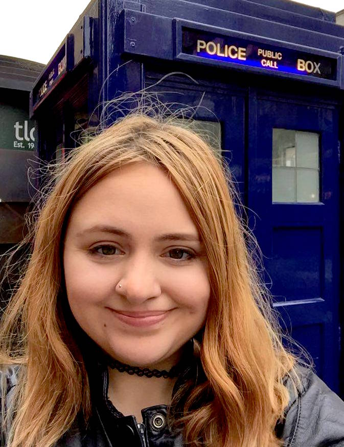 Posing in front of the police box (or TARDIS) outside Earl's Court station.