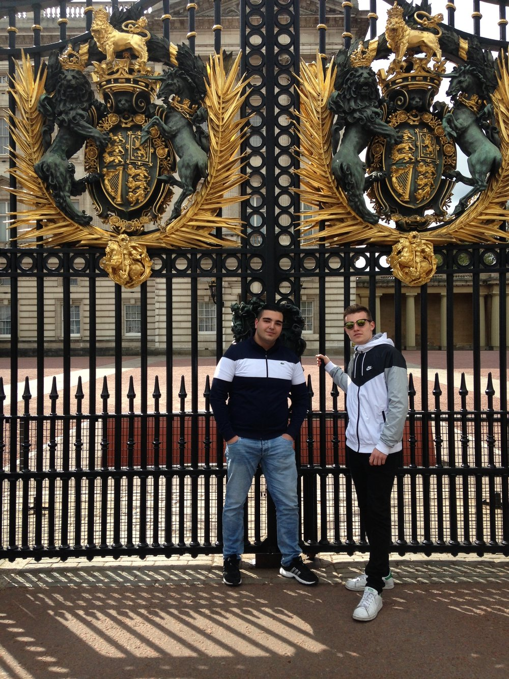 Gökai with a friend outside Buckingham Palace.