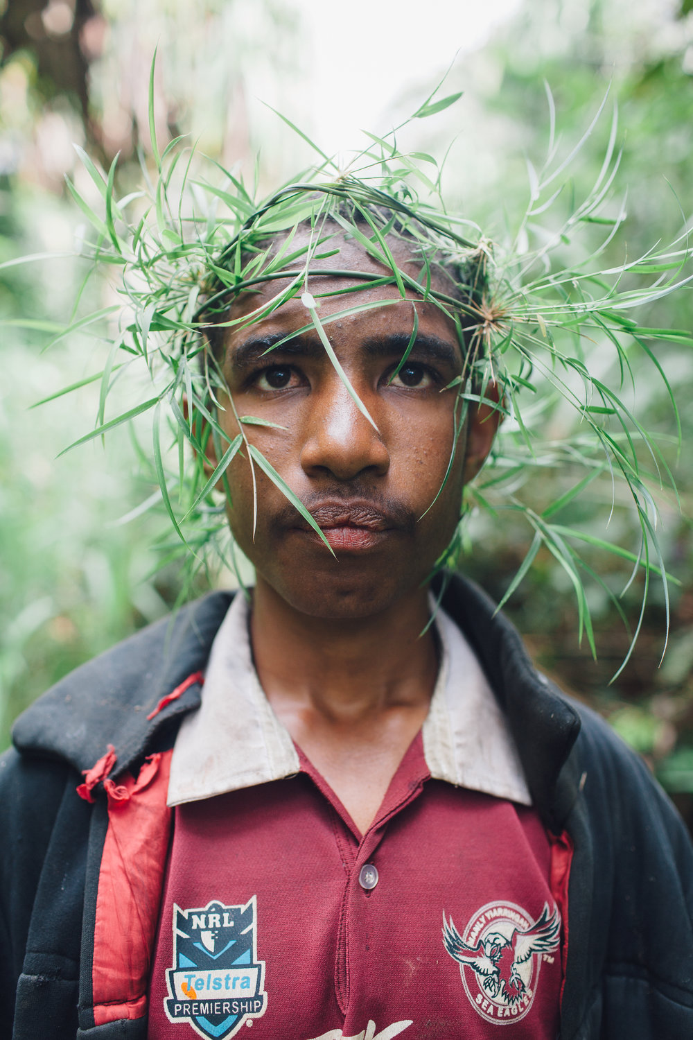 Kennedy with a crown of bamboo, protection from the bush men, Kum Caves.jpg