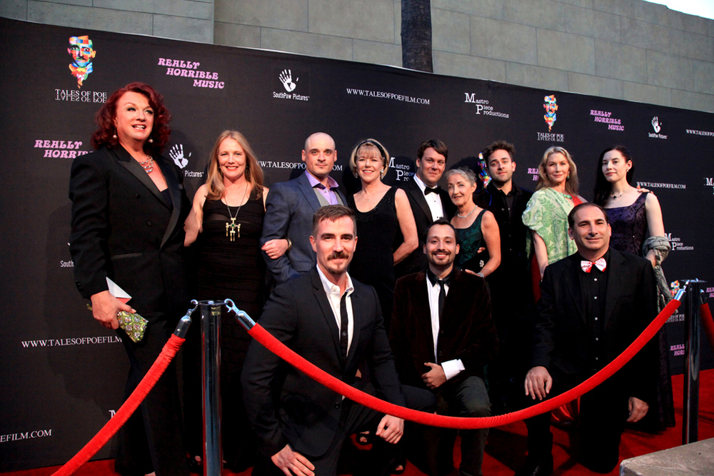 TALES OF POE Cast & Crew line up for a group picture- L to R - Alan Rowe Kelly, Amy Steel, Bart Mastronardi, Brewster McCall, Adrienne King, Azmi Mert Erdem, Tom Burns, Katherine O'Sullivan, Michael Varrati, Caroline Williams, Michael Buscemi & Bette Cassatt.